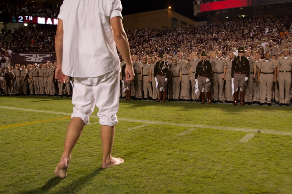 A Texas A&M Yell Leader prepares to be chased by Corps of Cadet's freshmen at the end of a Texas A&M home football game at Kyle Field in College Station, Texas.